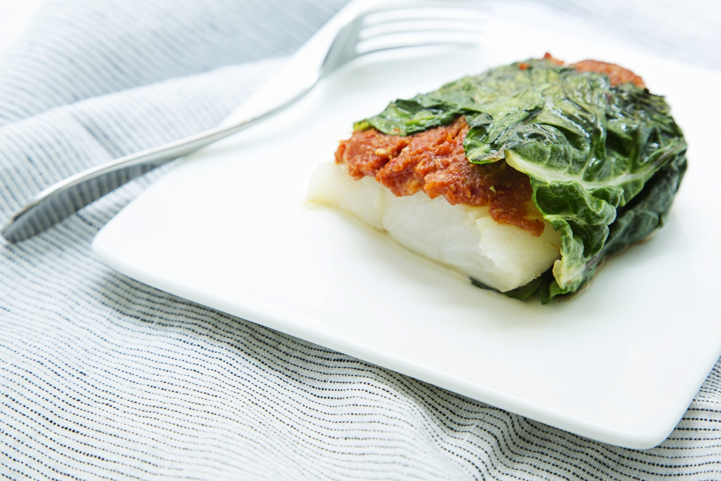 Chard-Wrapped Cod with Sun-Dried Tomato Tapenade
