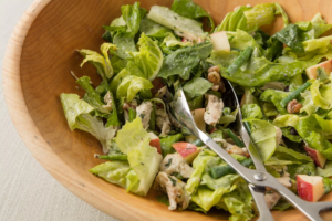 Green salad with walnuts, chicken, apples