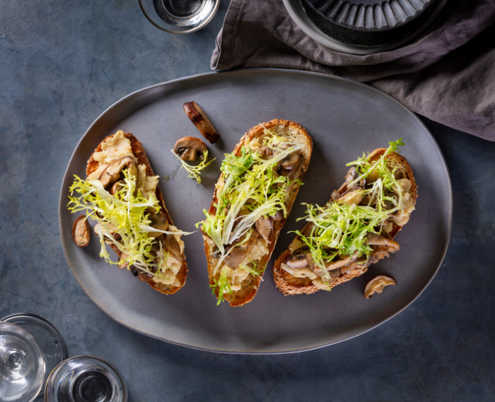 Mushroom White Bean Toasts with Frisée